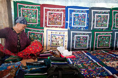 Seller of handmade embroidering products Royalty Free Stock Image