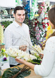 Seller helping to pick flowers man Royalty Free Stock Image