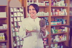 Seller holding dried herbs Royalty Free Stock Photo