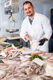Seller holding fish Royalty Free Stock Photo