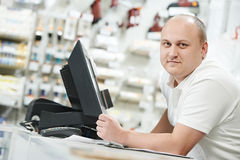 Seller at home improvement store Royalty Free Stock Image
