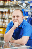 Seller at home improvement store. Happy seller assistant man in DIY hardware or home improvement store Royalty Free Stock Photography