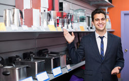 Seller at household appliances section Royalty Free Stock Photography