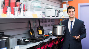 Seller at household appliances section Royalty Free Stock Image