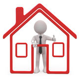 Seller of houses with a schematic house Stock Photo