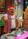 The seller of ice cream on the night street Royalty Free Stock Photography