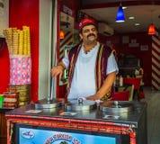 The seller of ice cream on the night street Stock Image