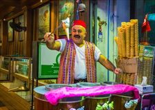 The seller of ice cream on the night street Royalty Free Stock Image
