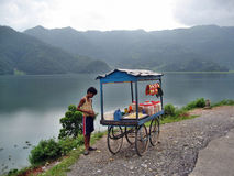 Seller by the lake. Young man selling by the lake nepal pokhara royalty free stock photography