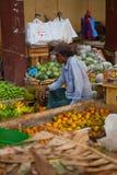 Seller on local market in Sri Lanka - April 2, 2014 Stock Images