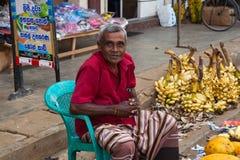 Seller on local market in Sri Lanka - April 2, 2014 Stock Photo