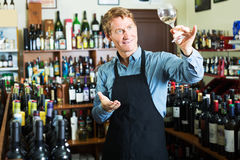 Seller man in wine store Royalty Free Stock Image
