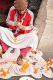 Seller men crafts from vegetables on the streets Royalty Free Stock Photos