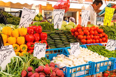 Seller near a counter with vegetables on a market in Venice, Ita Stock Photo