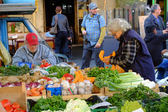 Seller Of Fruits And Vegetables Stock Photo