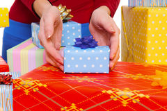 Seller offering a gift Stock Photography
