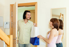 Seller offering quality products with a woman in the family Stock Images