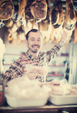 Seller offering sorts of meat Royalty Free Stock Images