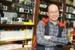 Seller at photo camera shop Royalty Free Stock Images