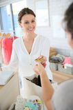 Seller receiving a credit card from the customer Stock Photography