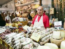 Seller of salami, hams and Italian cheeses. In a street market in the city of Foligno. Umbria region, central Italy royalty free stock photos