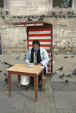 Seller of seeds for pigeons Stock Image