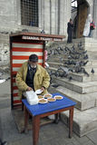 Seller of seeds for pigeons Royalty Free Stock Photography