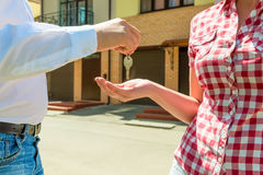 Seller sends the house key new owner hands. Closeup Royalty Free Stock Photos
