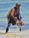 Seller shells washes mining Royalty Free Stock Photo