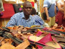 Seller of shoes. African seller of leather shoes to the suq in Genova Italy Stock Photography