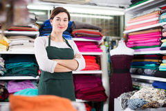 Seller showing assortment. Female shop assistant demonstrating assortment at drapery shop Stock Photos