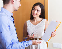 Seller showing documents indoors Royalty Free Stock Image