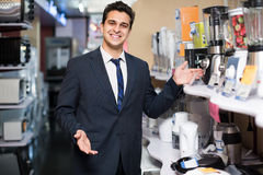 Seller at small household appliances section Royalty Free Stock Photography