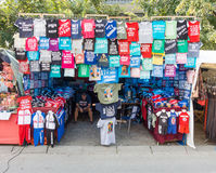 Seller of souvenir shirts in the town of Leskovac in Serbia royalty free stock photography