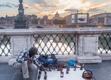 Seller of souvenirs on a bridge Sant`Angelo, Rome Royalty Free Stock Photos