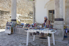 A seller of souvenirs intermigling mosque Stock Photo