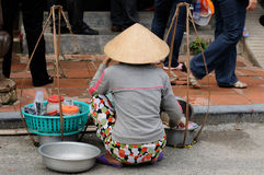 Seller on the street in Vietnam Royalty Free Stock Photography