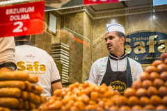 Seller of turkish sweets Stock Photos