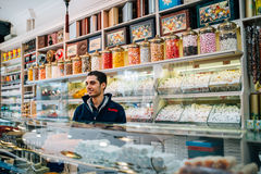 Seller of turkish sweets Royalty Free Stock Image