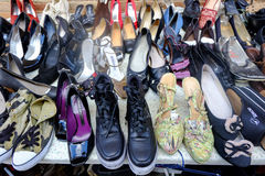 Seller of used shoes Royalty Free Stock Images