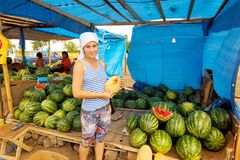 The seller of watermelons and melons on the roadside market stock photography