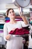 Seller weighing fabric Stock Photos