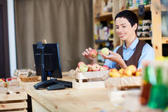 Seller at work Royalty Free Stock Photography