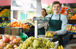 Sellers with bananas at market Stock Image