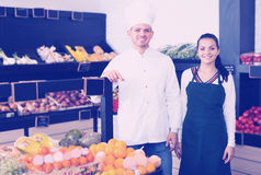 Sellers displaying assortment of grocery shop. Positive sellers displaying assortment of grocery shop stock photo