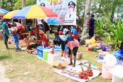 Sellers on Mansinam. Sellers of fruits and drinks on Christian celebration of arrival of first missionaries Ottow and Geissler on island Mansinam - Papua Barat stock photography
