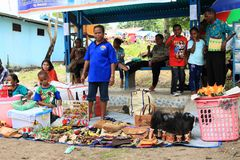 Sellers on Mansinam. Sellers of gifts and traditional bags called noken on Christian celebration of arrival of first missionaries Ottow and Geissler on island royalty free stock images