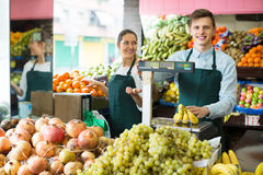 Sellers offering bananas at market Royalty Free Stock Image