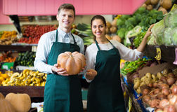 Sellers offering large squash Royalty Free Stock Image