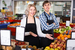 Sellers posing with fruits Stock Image
